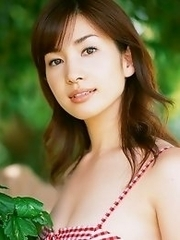 Enchanting asian chick Junko Yaginuma tempts at the beach with her soft boobs