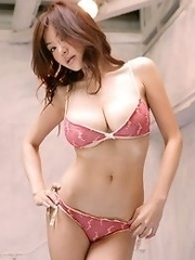 Beautiful asian chick with big bouncy boobs in a tight bikini